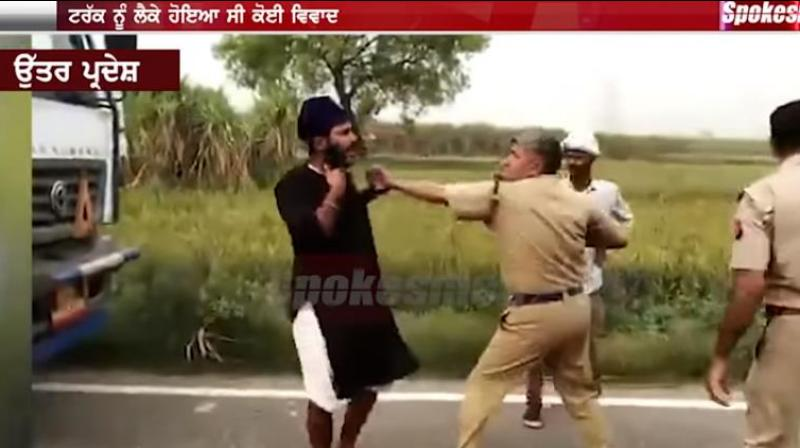 Sikh truck driver confronted up police cops with his sword after pulled his beard