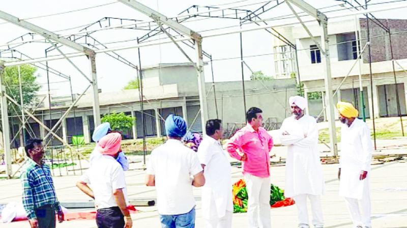 Manpreet Singh Badal is reviewing the rally place